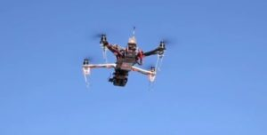 small UAV being controlled by drone pilot in Nevada