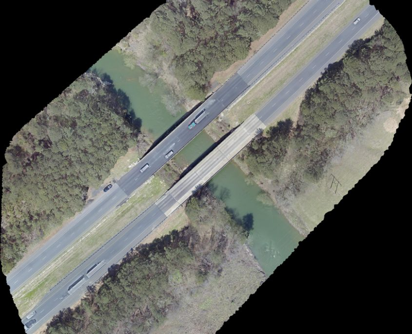 Aerial view above interstate highway bridge taken by drone.